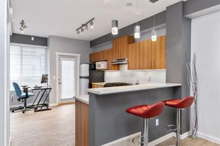 "Photo 3: 18 100 KLAHANIE Drive in Port Moody: Port Moody Centre Townhouse for sale in ""INDIGO-KLAHANIE"" : MLS®# R2473657"