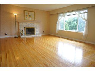 Photo 2: 1545 CORNELL AV in Coquitlam: Central Coquitlam House for sale : MLS®# V1058470