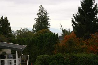 Photo 1: 13452 16 AVENUE in Surrey: Crescent Bch Ocean Pk. House 1/2 Duplex for sale (South Surrey White Rock)  : MLS®# R2001051