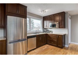 Photo 2: 1493 LAKE MICHIGAN CR SE in Calgary: Bonavista Downs House for sale : MLS®# C4054541