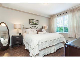 "Photo 10: 112 6480 194 Street in Surrey: Clayton Condo for sale in ""WATERSTONE - ESPLANADE"" (Cloverdale)  : MLS®# R2391477"