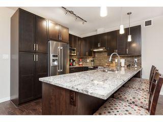"Photo 9: 112 6480 194 Street in Surrey: Clayton Condo for sale in ""WATERSTONE - ESPLANADE"" (Cloverdale)  : MLS®# R2391477"