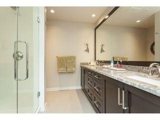 "Photo 11: 112 6480 194 Street in Surrey: Clayton Condo for sale in ""WATERSTONE - ESPLANADE"" (Cloverdale)  : MLS®# R2391477"