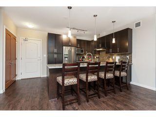 "Photo 6: 112 6480 194 Street in Surrey: Clayton Condo for sale in ""WATERSTONE - ESPLANADE"" (Cloverdale)  : MLS®# R2391477"