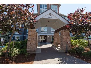 "Photo 1: 112 6480 194 Street in Surrey: Clayton Condo for sale in ""WATERSTONE - ESPLANADE"" (Cloverdale)  : MLS®# R2391477"