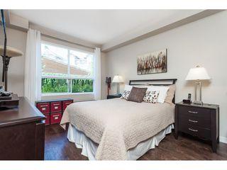 "Photo 12: 112 6480 194 Street in Surrey: Clayton Condo for sale in ""WATERSTONE - ESPLANADE"" (Cloverdale)  : MLS®# R2391477"