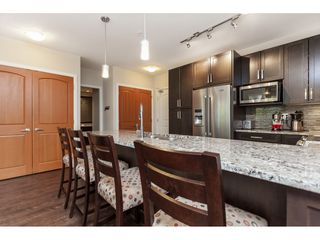 "Photo 7: 112 6480 194 Street in Surrey: Clayton Condo for sale in ""WATERSTONE - ESPLANADE"" (Cloverdale)  : MLS®# R2391477"