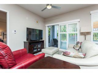 "Photo 4: 112 6480 194 Street in Surrey: Clayton Condo for sale in ""WATERSTONE - ESPLANADE"" (Cloverdale)  : MLS®# R2391477"