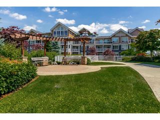 "Photo 16: 112 6480 194 Street in Surrey: Clayton Condo for sale in ""WATERSTONE - ESPLANADE"" (Cloverdale)  : MLS®# R2391477"