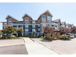 "Photo 2: 112 6480 194 Street in Surrey: Clayton Condo for sale in ""WATERSTONE - ESPLANADE"" (Cloverdale)  : MLS®# R2391477"