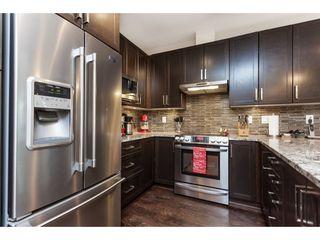 "Photo 8: 112 6480 194 Street in Surrey: Clayton Condo for sale in ""WATERSTONE - ESPLANADE"" (Cloverdale)  : MLS®# R2391477"