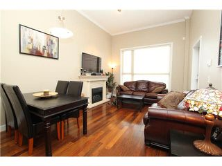 "Photo 1: 407 2627 SHAUGHNESSY Street in Port Coquitlam: Central Pt Coquitlam Condo for sale in ""VILLAGIO"" : MLS®# V1076806"