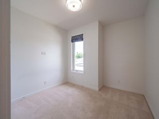 Photo 27: 35B MONCTON Road NE in Calgary: Winston Heights/Mountview Semi Detached for sale : MLS®# A1024659