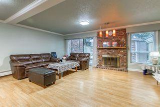 "Photo 2: 214 13933 74 Avenue in Surrey: East Newton Townhouse for sale in ""GLENCO ESTATES"" : MLS®# R2517919"