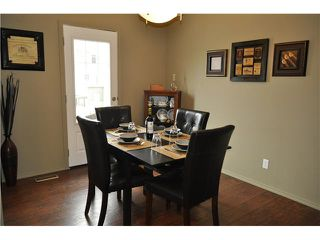 Photo 8: 64 WINDSTONE Green SW: Airdrie Townhouse for sale : MLS®# C3629867
