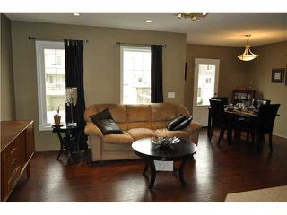 Photo 3: 64 WINDSTONE Green SW: Airdrie Townhouse for sale : MLS®# C3629867