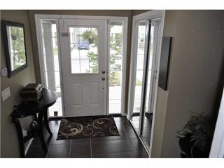 Photo 2: 64 WINDSTONE Green SW: Airdrie Townhouse for sale : MLS®# C3629867