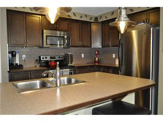 Photo 6: 64 WINDSTONE Green SW: Airdrie Townhouse for sale : MLS®# C3629867