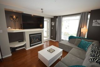 "Photo 1: 202 3148 ST JOHNS Street in Port Moody: Port Moody Centre Condo for sale in ""Sunrisa"" : MLS®# R2509530"
