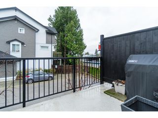 "Photo 33: 32 14271 60 Avenue in Surrey: Sullivan Station Townhouse for sale in ""BLACKBERRY WALK"" : MLS®# R2518056"