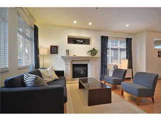 """Photo 2: 1726 E 7TH Avenue in Vancouver: Grandview VE House 1/2 Duplex for sale in """"Commercial Drive"""" (Vancouver East)  : MLS®# V938494"""