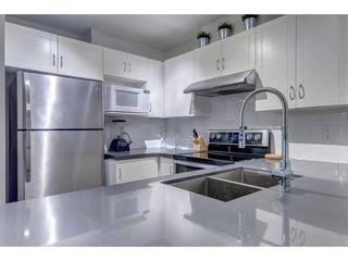 Photo 5: 105 3033 TERRAVISTA PLACE in Port Moody: Port Moody Centre Condo for sale : MLS®# R2334845