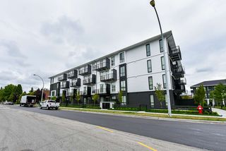 "Photo 1: 215 10168 149 Street in Surrey: Guildford Condo for sale in ""Guildhouse II"" (North Surrey)  : MLS®# R2388943"