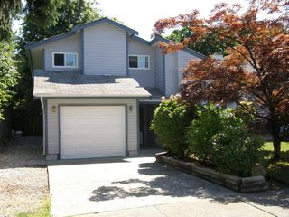 Photo 2: 3148 TOBA Drive in Coquitlam: Home for sale : MLS®# V1075139