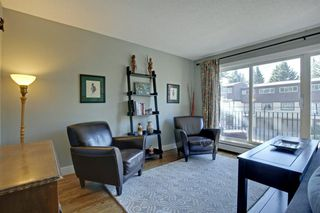 Photo 8: 824 3130 66 Avenue SW in Calgary: Lakeview Row/Townhouse for sale : MLS®# A1027980