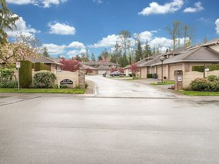 Photo 1: 104-6082 W. Boundary Drive in Surrey: Panorama Ridge Townhouse for sale : MLS®# r2052148