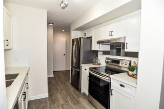 Photo 11: 213 2204 1 Street SW in Calgary: Mission Apartment for sale : MLS®# A1032440