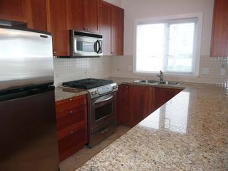 Photo 3: 201 4211 Bayview Street in The Village: Home for sale