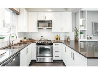 """Photo 1: 1278 SALSBURY Drive in Vancouver: Grandview VE Townhouse for sale in """"THE JEFFS RESIDENCES"""" (Vancouver East)  : MLS®# V993304"""