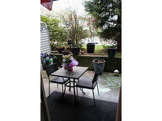 Photo 2: 103 2055 SUFFOLK Avenue in Port Coquitlam: Glenwood PQ Condo for sale : MLS®# V998156