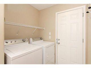 Photo 8: 23 AUBURN BAY Place SE in CALGARY: Auburn Bay Residential Detached Single Family for sale (Calgary)  : MLS®# C3572097