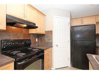 Photo 4: 23 AUBURN BAY Place SE in CALGARY: Auburn Bay Residential Detached Single Family for sale (Calgary)  : MLS®# C3572097