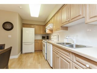 """Photo 8: 225 13880 70 Avenue in Surrey: East Newton Condo for sale in """"Chelsea Gardens- The Windsor Building"""" : MLS®# R2398385"""