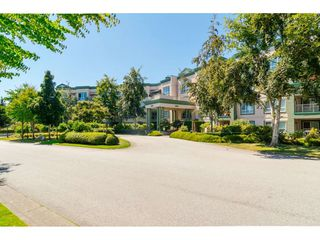 "Photo 1: 225 13880 70 Avenue in Surrey: East Newton Condo for sale in ""Chelsea Gardens- The Windsor Building"" : MLS®# R2398385"