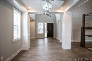 Photo 9: 213 Aspenmere Way: Chestermere Detached for sale : MLS®# C4297523