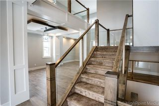 Photo 8: 213 Aspenmere Way: Chestermere Detached for sale : MLS®# C4297523