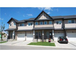 Photo 1: 3 CIMARRON VISTA Gardens: Okotoks Townhouse for sale : MLS®# C3627609