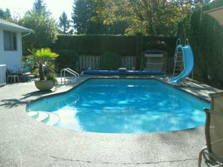 Photo 8: 7642 KERRYWOOD in Burnaby: Government Road House for sale (Burnaby North)  : MLS®# V618333