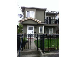 Photo 1: 1843 E 12TH Avenue in Vancouver: Grandview VE House 1/2 Duplex for sale (Vancouver East)  : MLS®# V946824