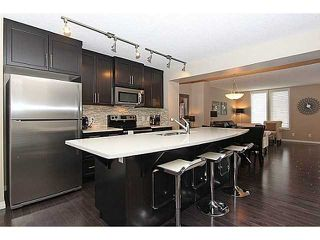 Photo 4: 43 AUBURN BAY Link SE in : Auburn Bay Townhouse for sale (Calgary)  : MLS®# C3585164