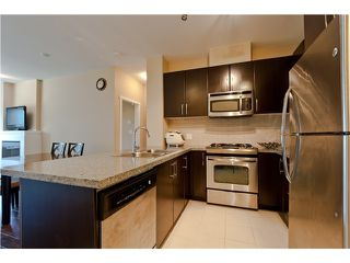 Photo 4: # 411 701 KLAHANIE DR in Port Moody: Port Moody Centre Condo for sale : MLS®# V1002002