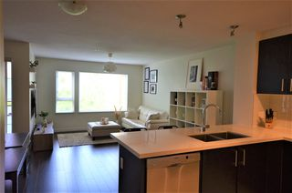 "Photo 1: 320 3163 RIVERWALK Avenue in Vancouver: South Marine Condo for sale in ""NEW WATER BY POLYGON"" (Vancouver East)  : MLS®# R2455725"