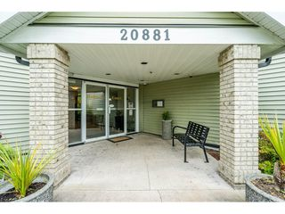 "Photo 2: 103 20881 56 Avenue in Langley: Langley City Condo for sale in ""ROBERT'S COURT"" : MLS®# R2467971"