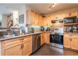 """Photo 3: 103 20881 56 Avenue in Langley: Langley City Condo for sale in """"ROBERT'S COURT"""" : MLS®# R2467971"""