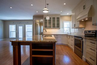 Photo 9: 1033 CHANNELSIDE Way SW: Airdrie Detached for sale : MLS®# A1010658