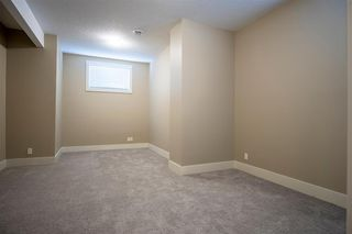 Photo 36: 1033 CHANNELSIDE Way SW: Airdrie Detached for sale : MLS®# A1010658